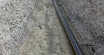 Werkleitungsgraben der neuen Gasleitung und der bereits überdeckten Wasserleitung